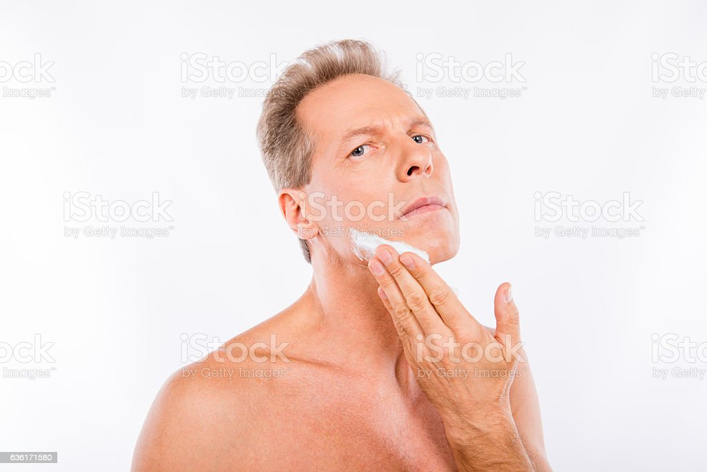 Handsome mature man creaming in front of camera stock photo