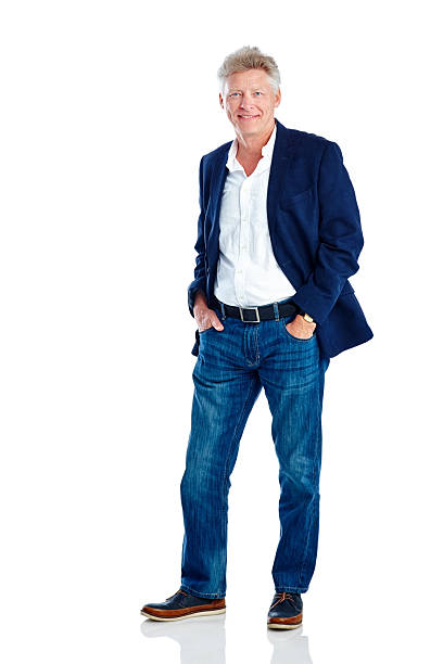 Handsome mature man posing in smart casuals Studio shot of handsome mature man posing in smart casuals on white background hands in pockets stock pictures, royalty-free photos & images