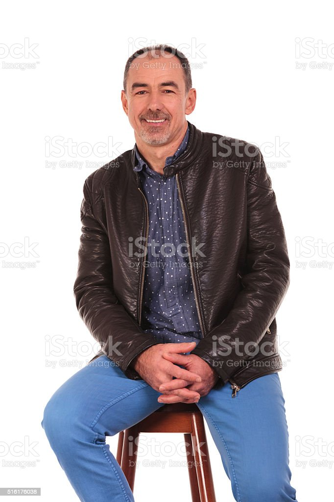 handsome mature man posing seated stock photo