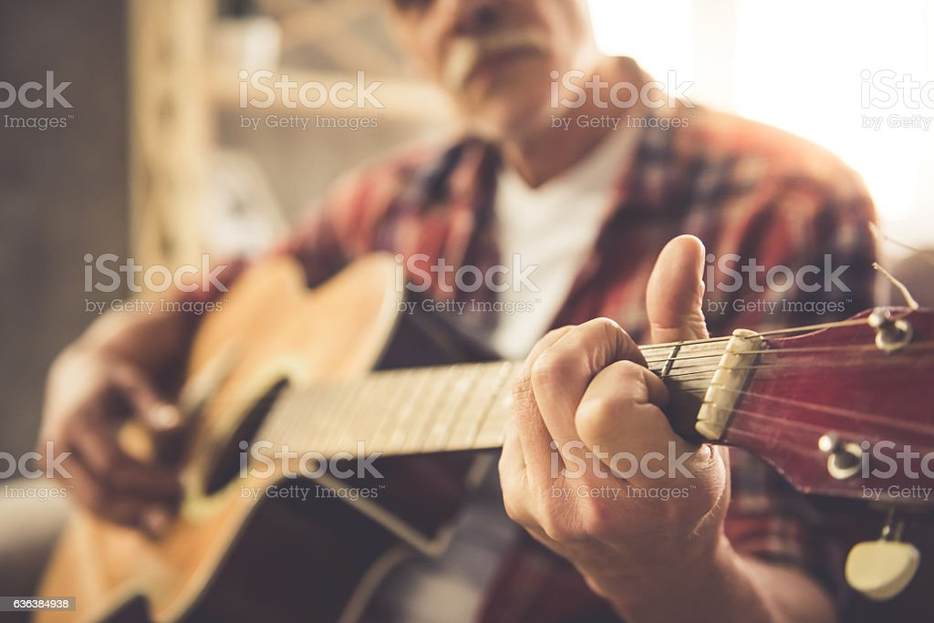Handsome mature man with guitar stock photo