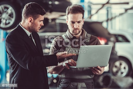 istock Handsome mechanic and businessman 673720520