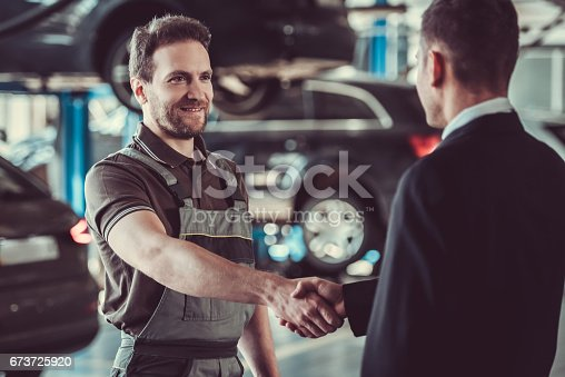 1073743202 istock photo Handsome mechanic and businessman 673725920