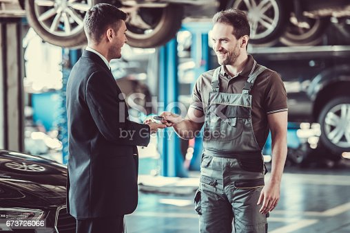 1073743202 istock photo Handsome mechanic and businessman 673726066