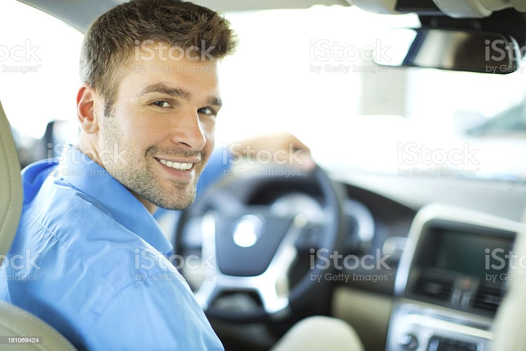 Handsome men in a car. royalty-free stock photo