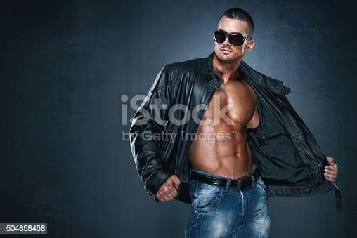 portrait of a fashionable handsome male model posing