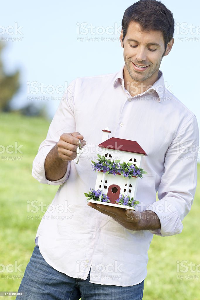 handsome men posing with house miniature royalty-free stock photo