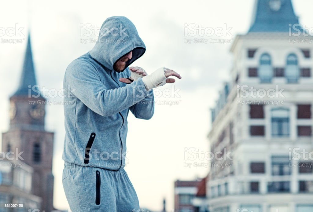 Handsome Middle Aged Bearded Man Exercising Outdoors in Northern Europe stock photo