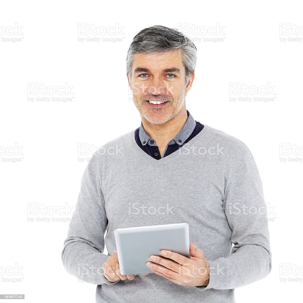 Handsome middle aged guy with a tablet computer royalty-free stock photo