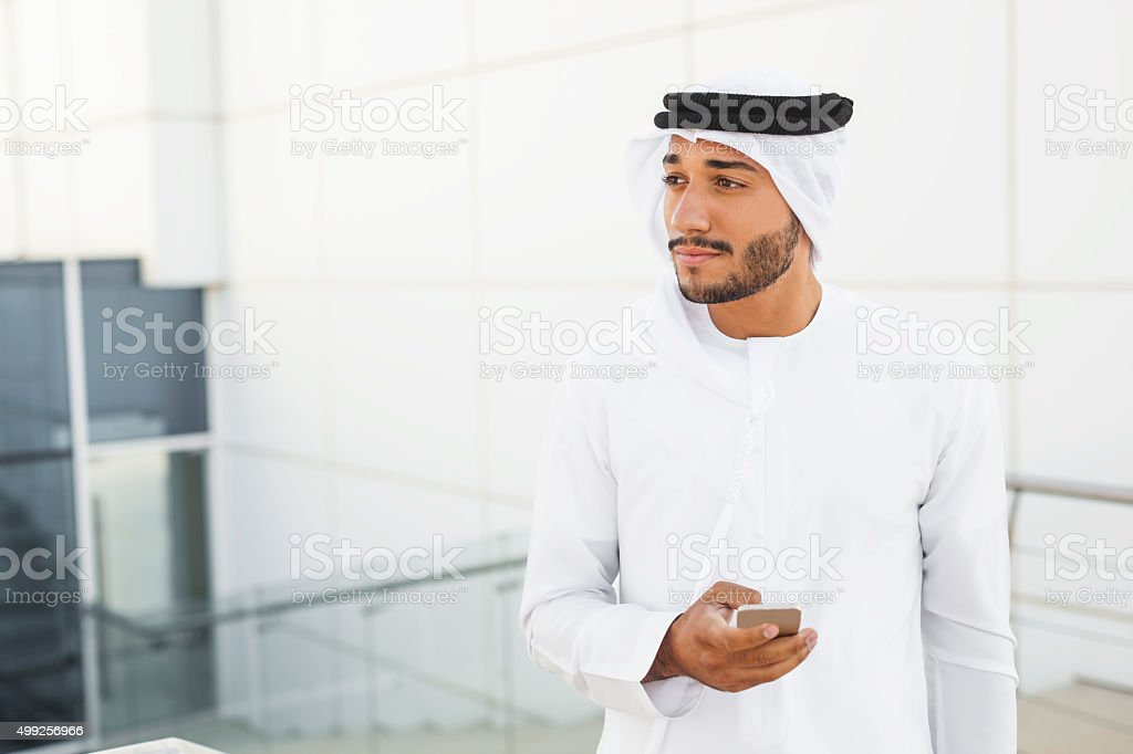 Handsome Middle Eastern Man On The Phone Outside Office stock photo