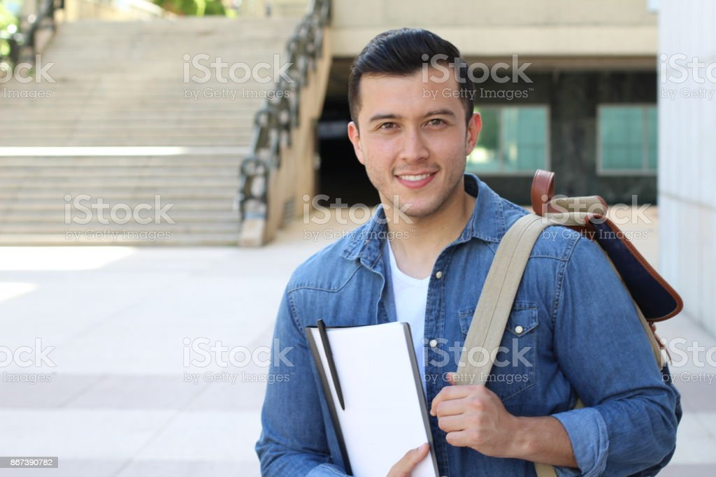Handsome mixed race person heading to school stock photo