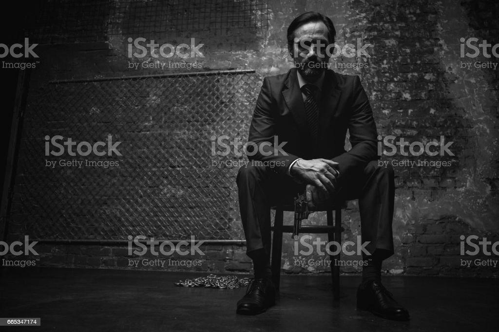Handsome modern villain radiating danger stock photo