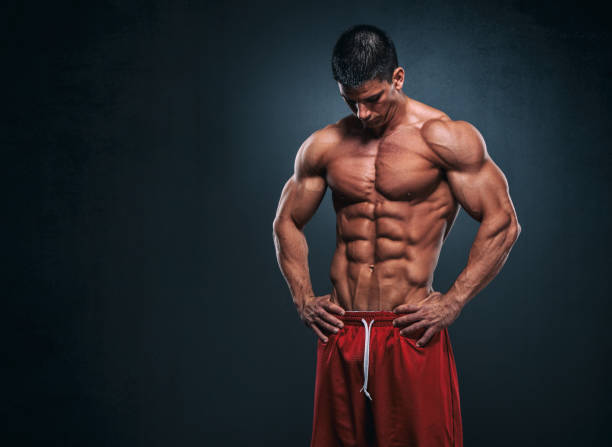 Handsome Mucular Men Flexing  Abdominal Muscles, Abs stock photo