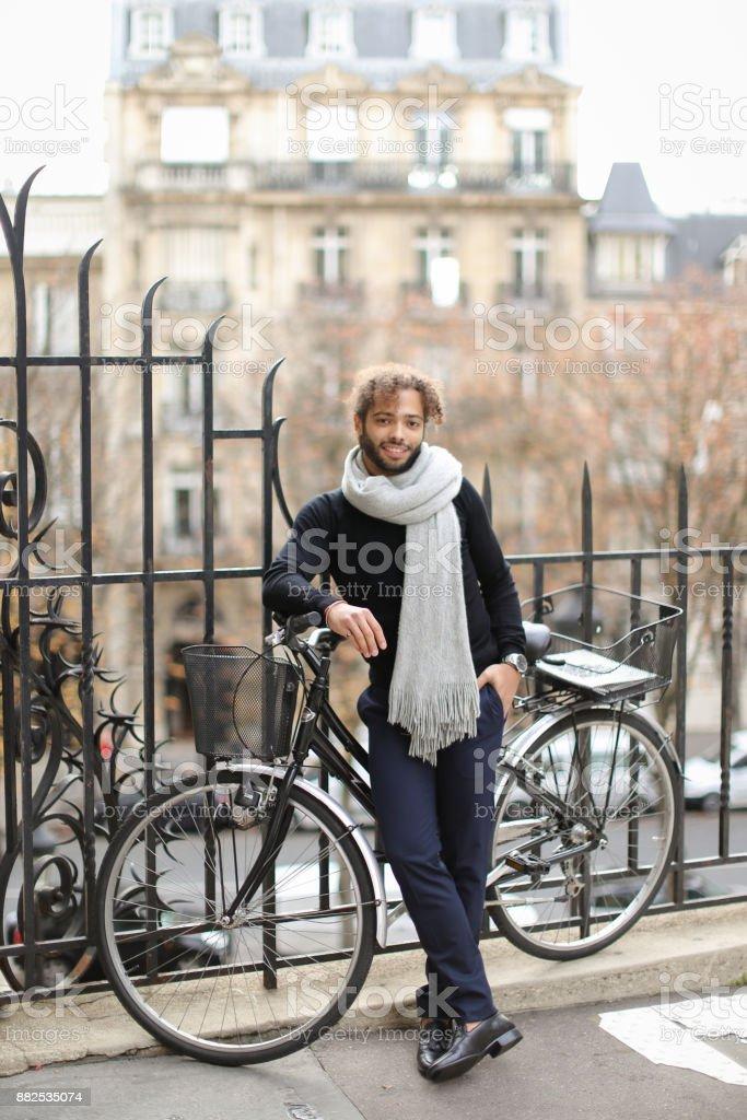 Handsome mulatto gentleman waiting for girlfriend stock photo