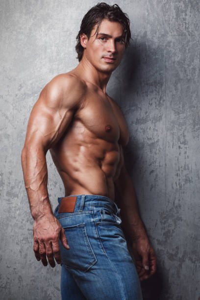 Handsome muscle man Handsome muscle man in jeans shirtless male models stock pictures, royalty-free photos & images