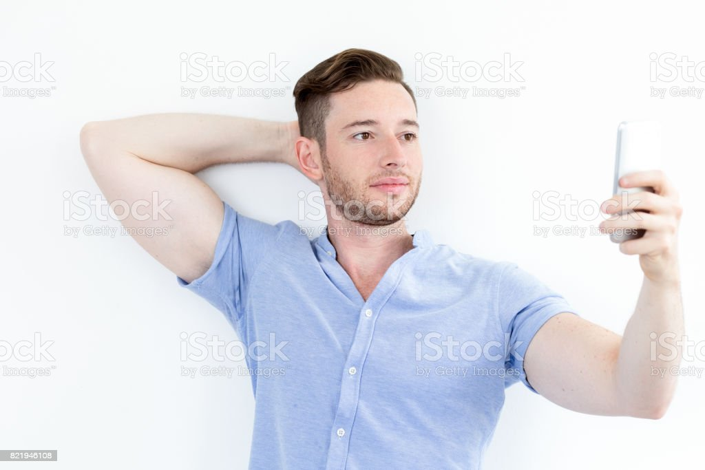 Handsome muscled young man posing for selfie stock photo