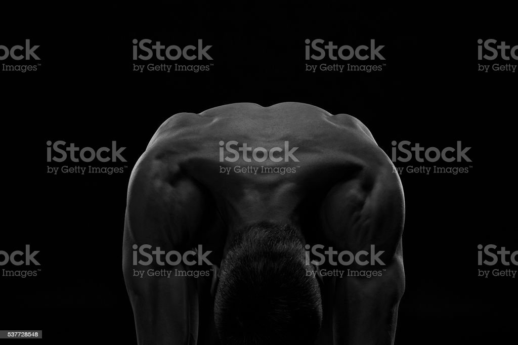 Handsome muscular bodybuilder posing on black background stock photo