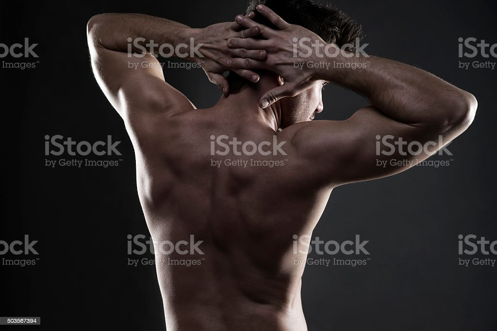 Handsome muscular bodybuilder posing stock photo