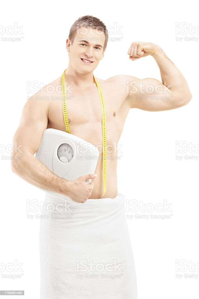 Handsome Muscular Man In Towel Holding A Weight Scale Stock Photo ... 26eba9a23