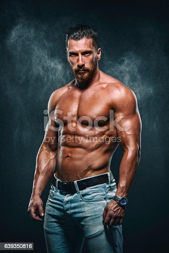 Portrait of Handsome Muscular Man in jeans