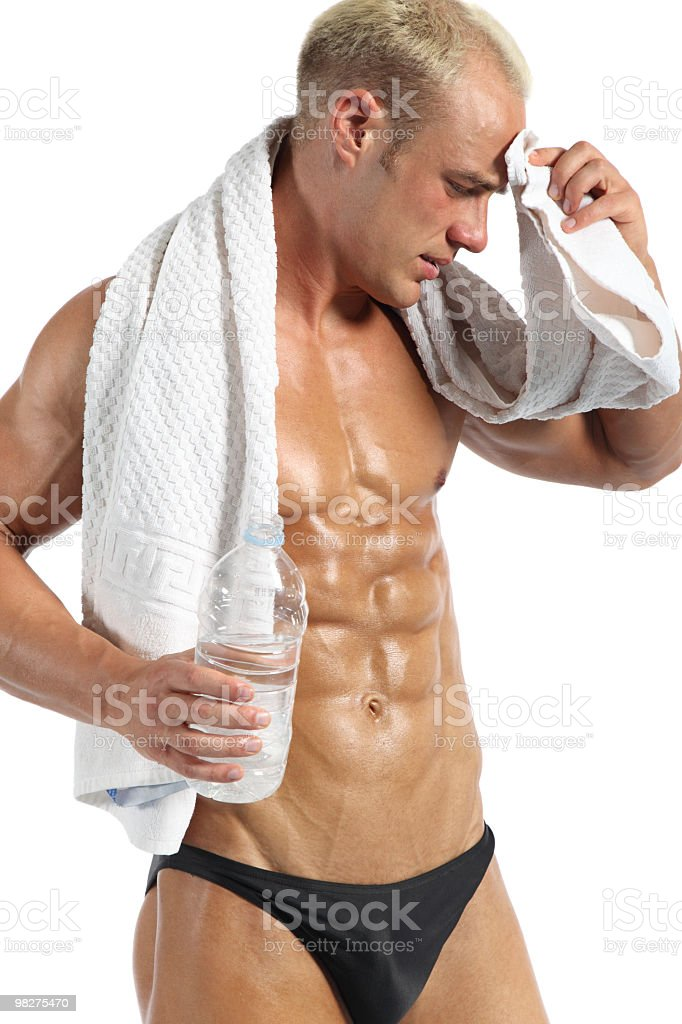 Handsome muscular man relaxing after hard training royalty-free stock photo