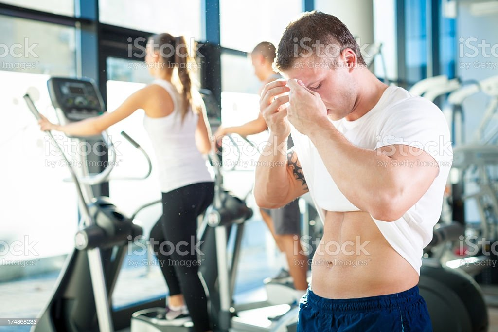 Handsome muscular man resting at the gym royalty-free stock photo