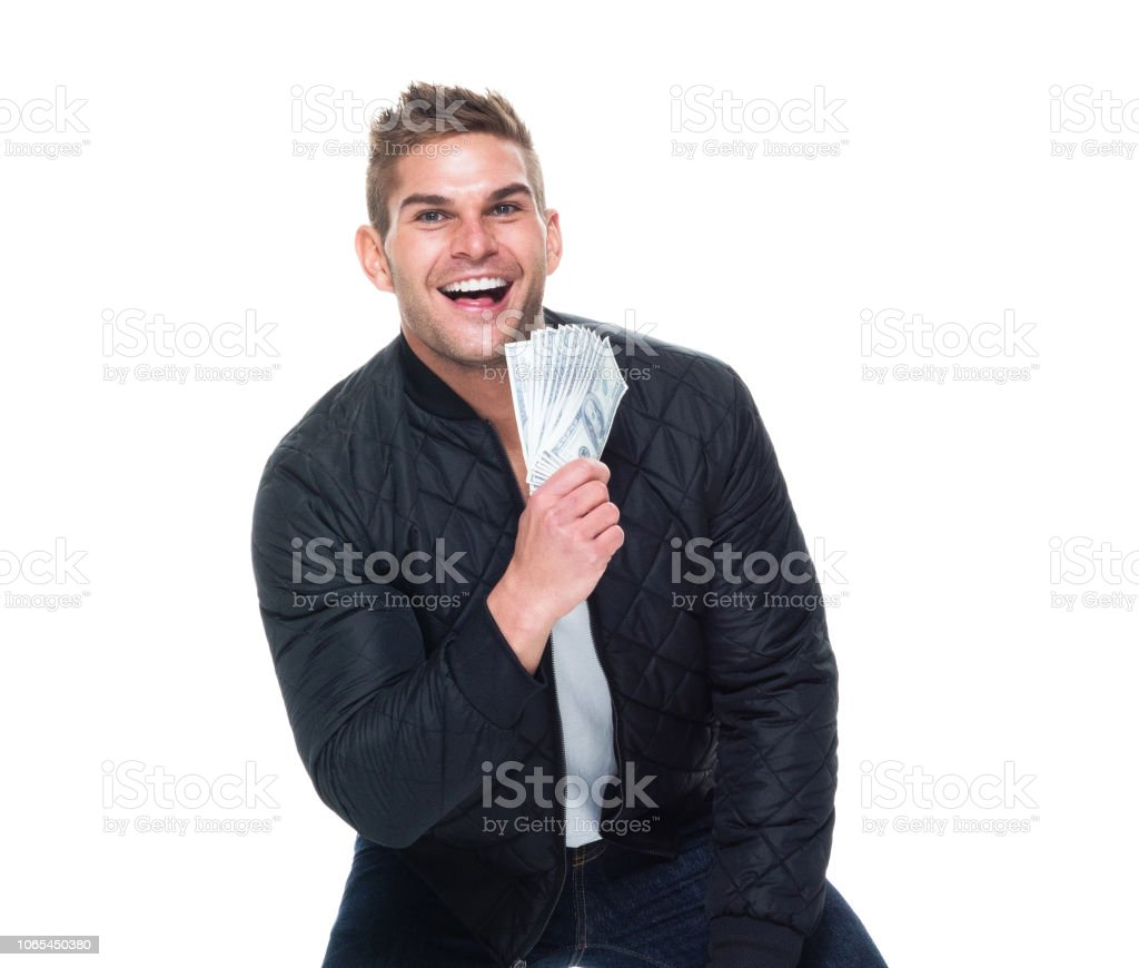 Handsome muscular man showing off a ton of money stock photo