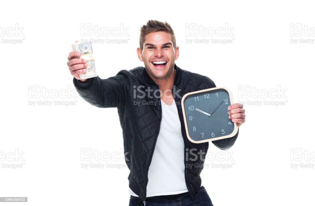 Handsome muscular man showing that time is money stock photo