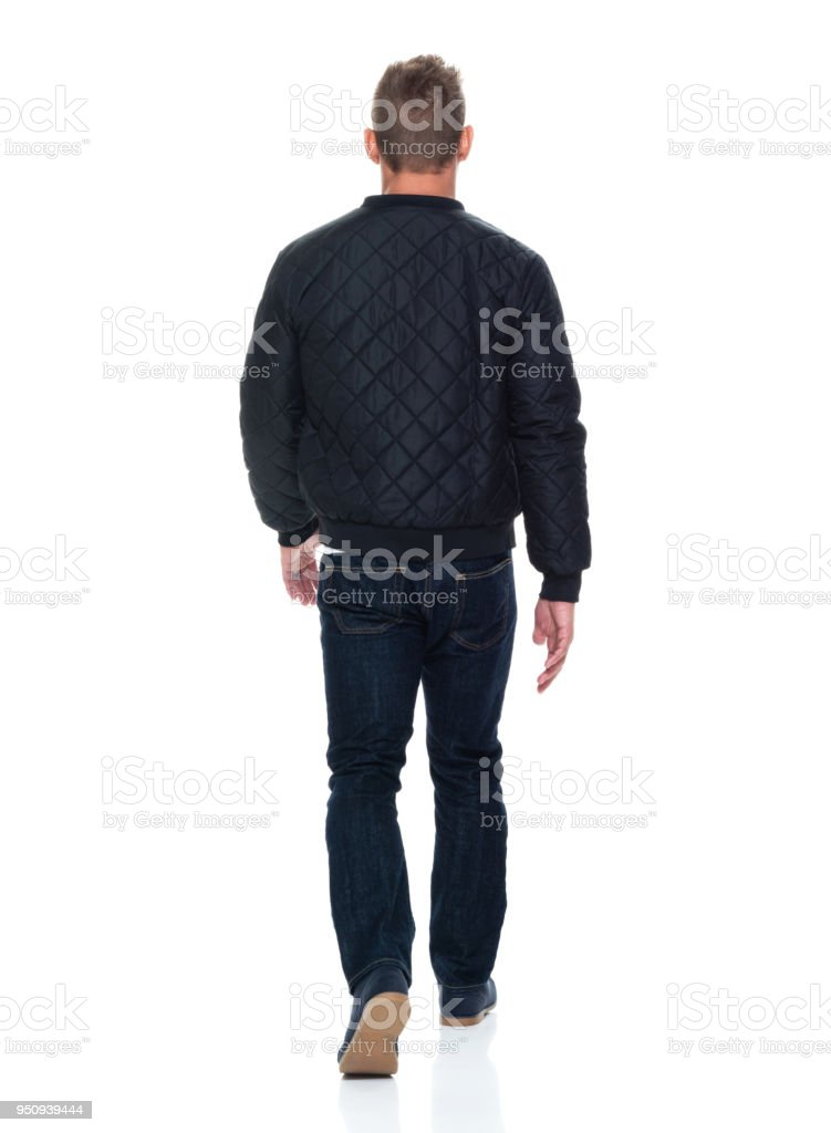 Handsome muscular man walking stock photo