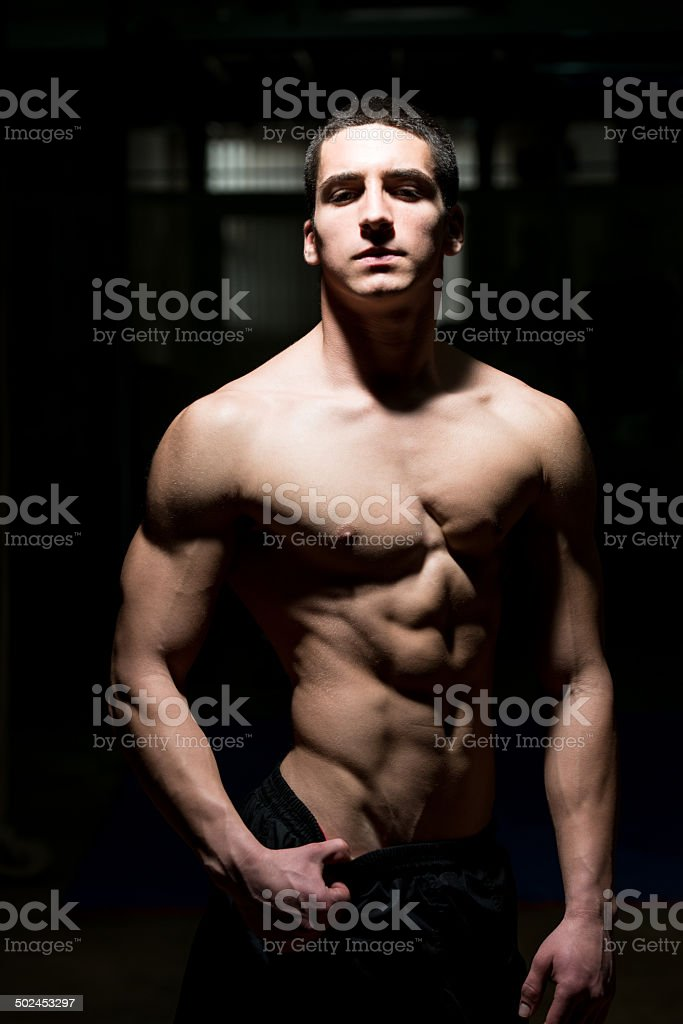 Handsome Muscular Men Flexing Muscles stock photo