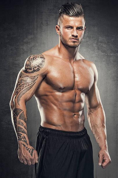 gut aussehend muskuläre herren - sexsymbol stock-fotos und bilder