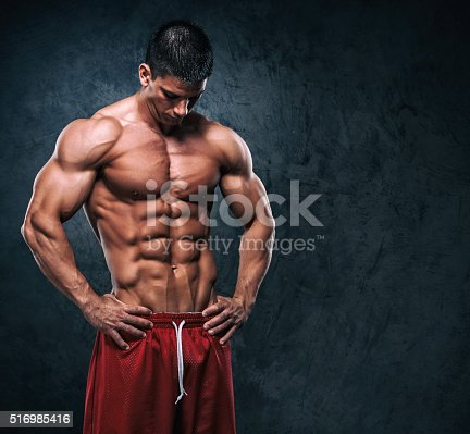 618209684istockphoto Handsome Muscular Men 516985416