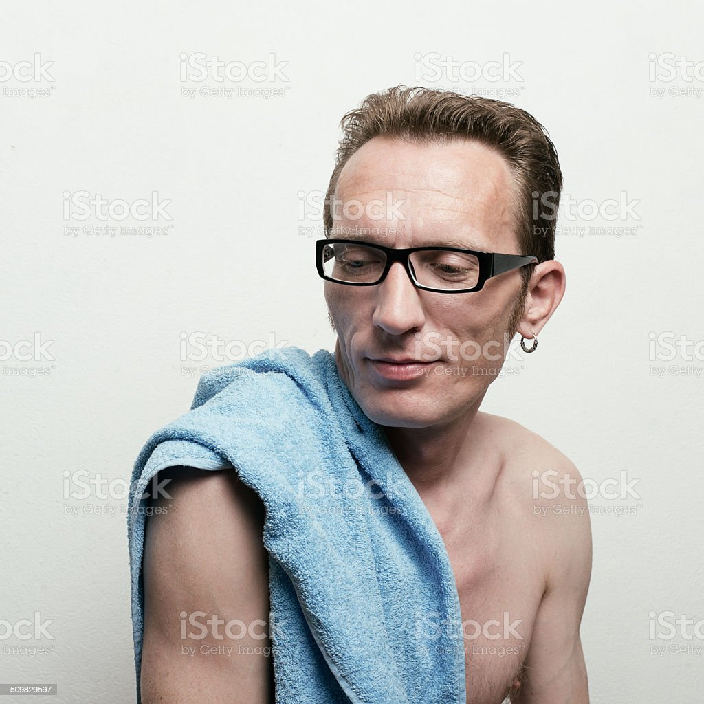 Handsome Naked Man In Spectacles With A Blue Towel Royalty Free Stock Photo