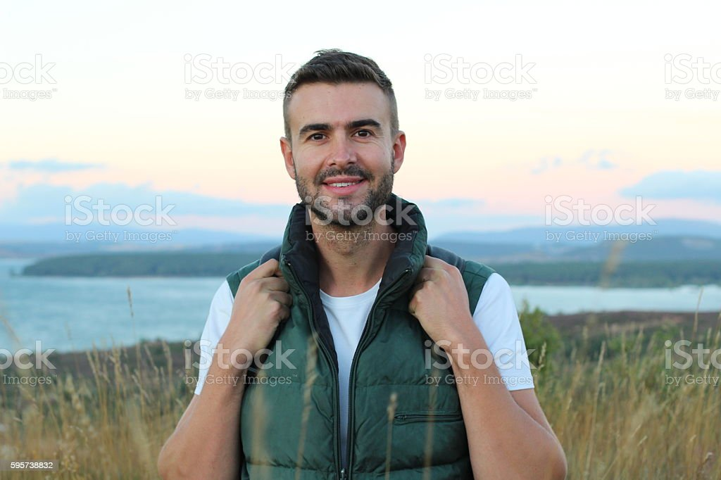 Handsome Natural Man Relaxing After Hiking stock photo