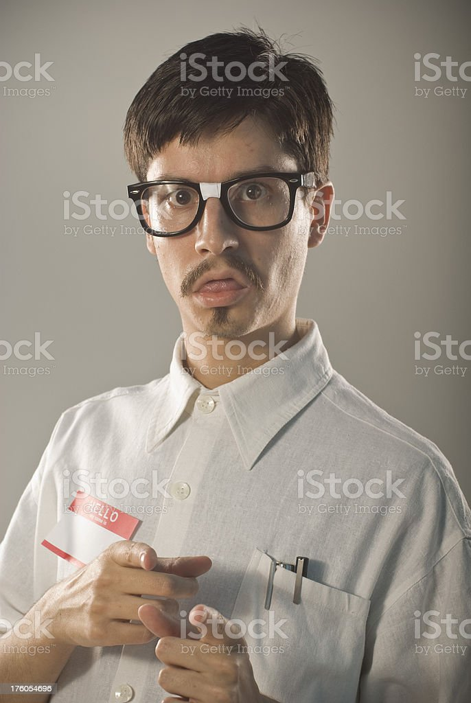 Handsome nerd pointing at you royalty-free stock photo