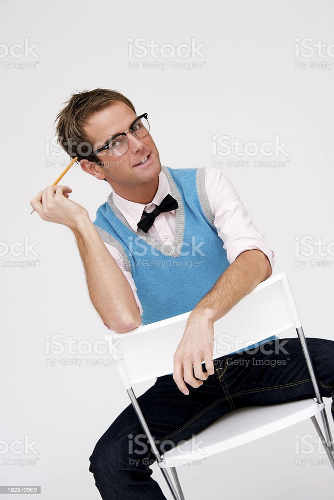 Handsome Nerd Sitting on a Chair royalty-free stock photo