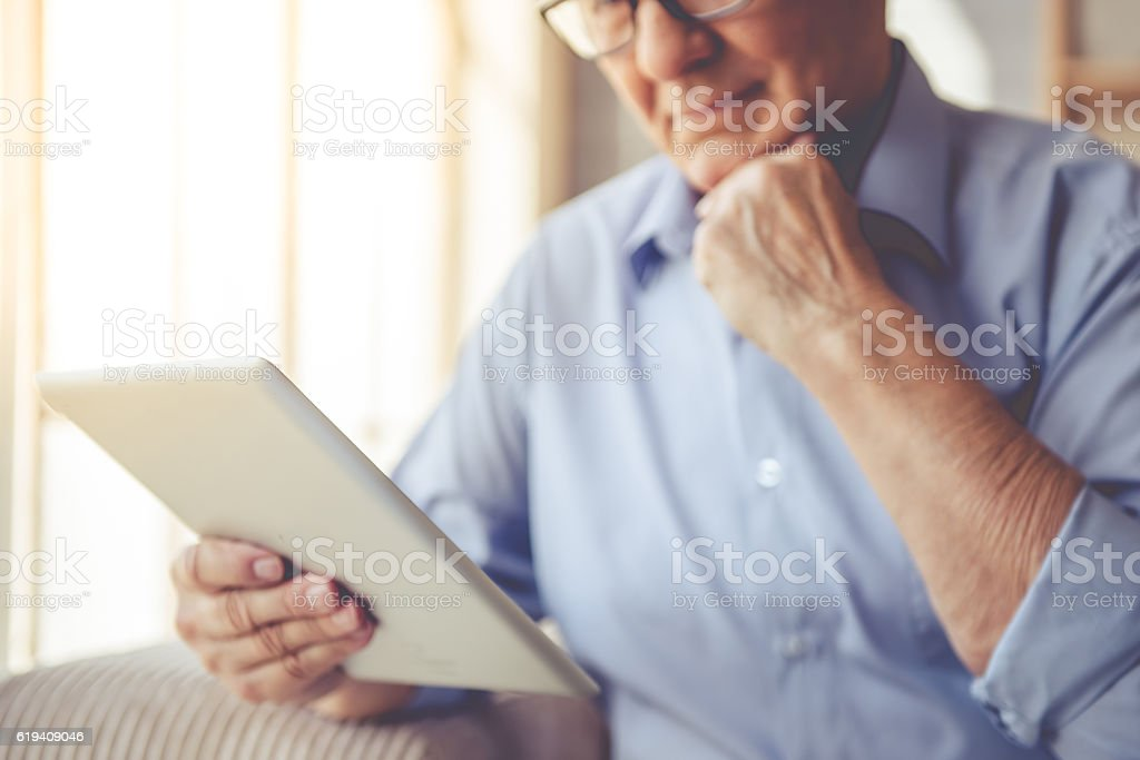 Handsome old man at home stock photo