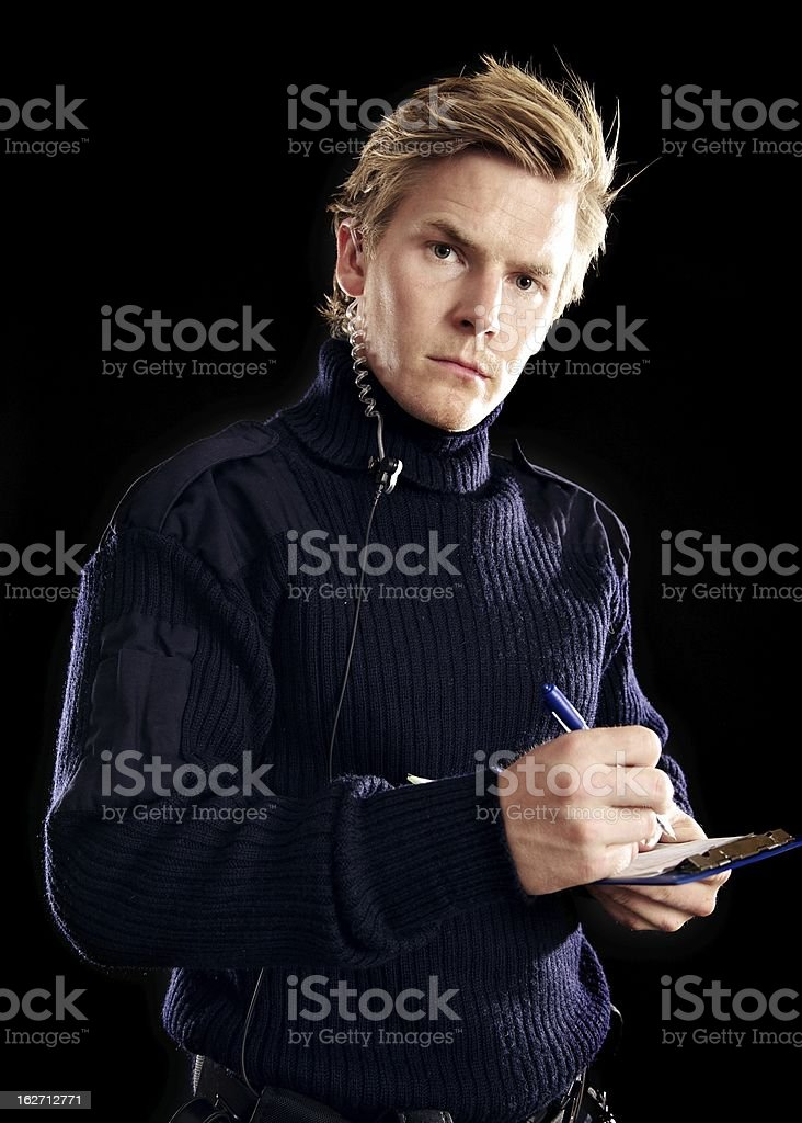 Handsome Police on Duty Writing Something royalty-free stock photo
