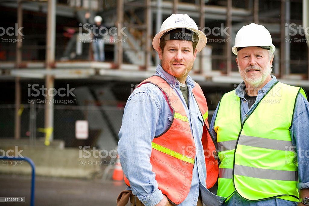 A handsome portraits of two construction workers royalty-free stock photo