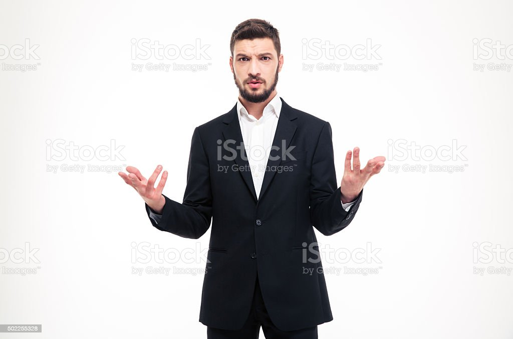 Handsome puzzled businessman with beard holding copyspace in both hands stock photo