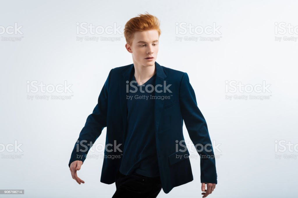 Handsome red-haired man looking down stock photo