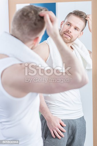 istock Handsome reflection in the mirror 505800344