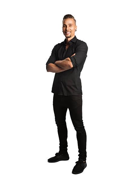 handsome relaxed man in shirt - zwarte spijkerbroek stockfoto's en -beelden