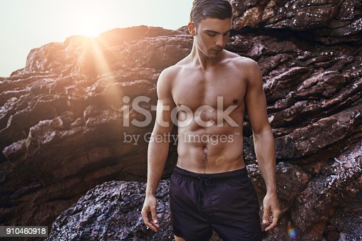 519676858 istock photo handsome ripped man 910460918
