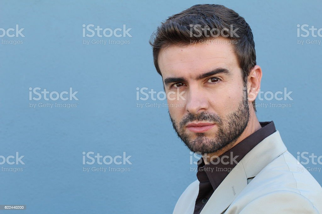 Handsome seductive man flirting at camera stock photo