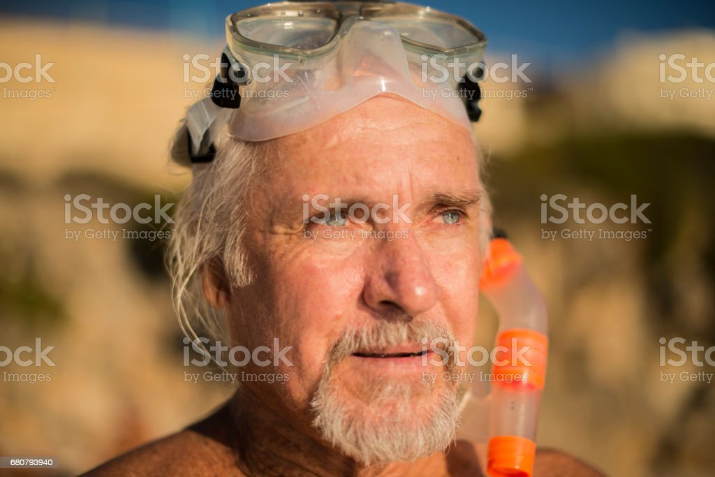 Handsome senior man at beach royalty-free stock photo