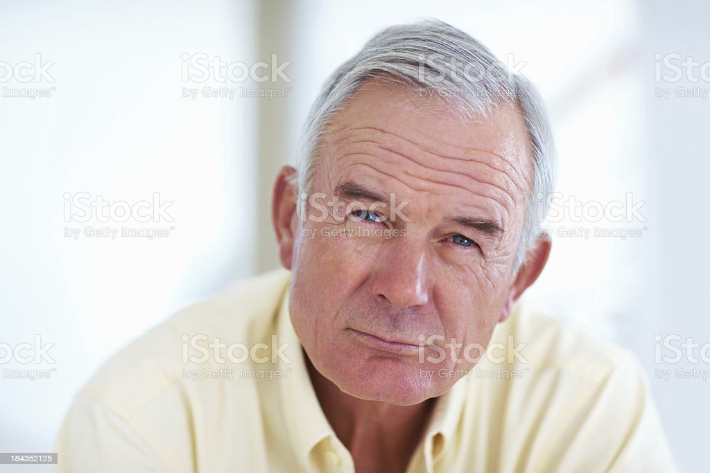 Handsome senior man looking at you royalty-free stock photo
