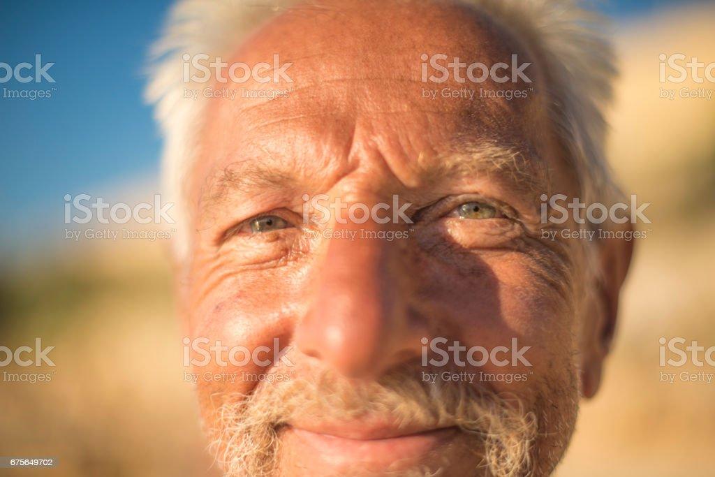Handsome senior man on beach royalty-free stock photo