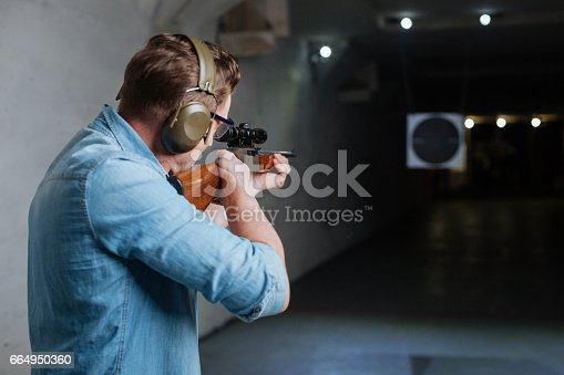istock Handsome serious man looking at the target 664950360