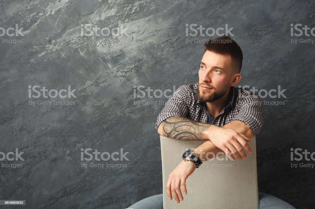Handsome serious man posing in studio royalty-free stock photo