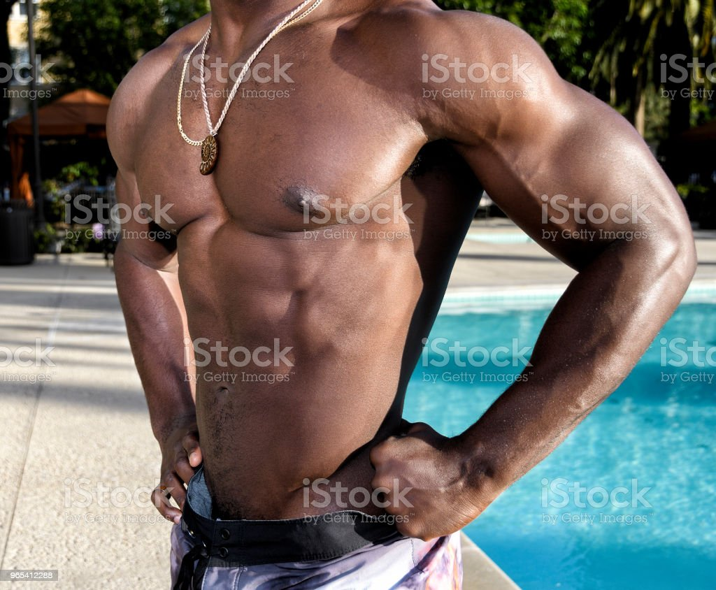 Handsome Shirtless Man by the Pool royalty-free stock photo